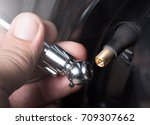 check the tire pressure with a... | Shutterstock . vector #709307662