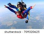 skydiving. tandem jump. | Shutterstock . vector #709320625