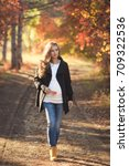 young pregnant woman walking in ...   Shutterstock . vector #709322536
