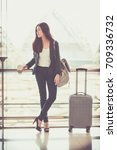 airport woman holding... | Shutterstock . vector #709336732