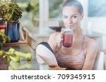 satisfied fit woman drinking... | Shutterstock . vector #709345915
