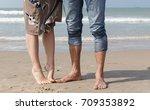 feet loving couple on the beach | Shutterstock . vector #709353892