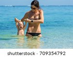 mom with babies bathe in a... | Shutterstock . vector #709354792