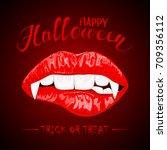 female lips with vampire fangs... | Shutterstock .eps vector #709356112