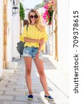Stock photo tourist woman on vacation in greece walking through the streets of lindos female model dressed in 709378615
