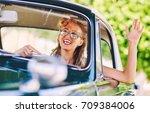 beautiful happy woman sitting...   Shutterstock . vector #709384006