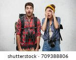 shocked hitch hikers carrying... | Shutterstock . vector #709388806