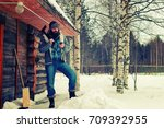 winter man axe wood | Shutterstock . vector #709392955