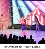 girls juggling with hoops on... | Shutterstock . vector #709412866