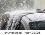 large hail stones pelting car...