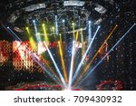 stage spotlight with laser rays | Shutterstock . vector #709430932