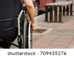 close up of male hand on wheel...   Shutterstock . vector #709435276