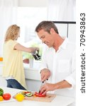 couple cooking together in... | Shutterstock . vector #70943863
