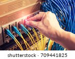 man working in network server... | Shutterstock . vector #709441825