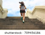 woman running up the stairs ... | Shutterstock . vector #709456186