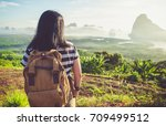 happy young traveler woman... | Shutterstock . vector #709499512