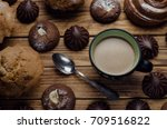 cup of coffee and biscuits  | Shutterstock . vector #709516822
