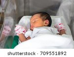new born infant asleep in the... | Shutterstock . vector #709551892