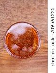 beer on wooden background.... | Shutterstock . vector #709561225