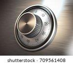 safe vault lock on metal door.... | Shutterstock . vector #709561408