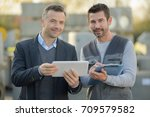 man with suit holding tablet... | Shutterstock . vector #709579582