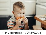 wonderful little child eating a ... | Shutterstock . vector #709591975