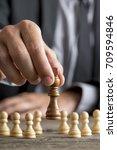 businessman playing chess... | Shutterstock . vector #709594846