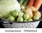 Dutch winter vegetables including carrots, potatoes, brussel sprouts, cabbage and leeks. Focus on the brussel sprouts - stock photo