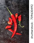 hot pepper cut on a black... | Shutterstock . vector #709630492