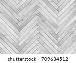 Stock photo natural gray wooden parquet herringbone wood texture 709634512