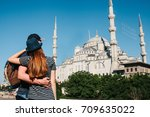 a couple of tourists a young... | Shutterstock . vector #709635022