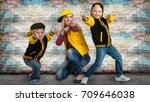 a young mother and two young... | Shutterstock . vector #709646038