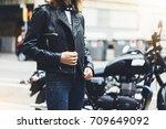 girl unfastens black leather... | Shutterstock . vector #709649092