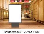 blank street billboard at night ...   Shutterstock . vector #709657438