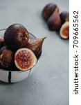 Small photo of Vertical photo of Fresh figs in bawl on gray background