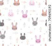 Stock vector tribal seamless pattern with cartoon rabbits abstract geometric art print hand drawn ethnic 709690192