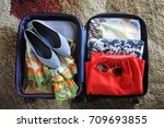 packed suitcase with woman's... | Shutterstock . vector #709693855