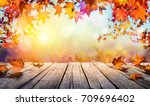 wooden table with orange leaves ... | Shutterstock . vector #709696402