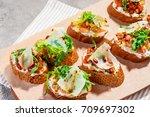 italian bruschetta with... | Shutterstock . vector #709697302