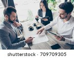 young business partners are... | Shutterstock . vector #709709305