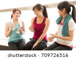sporty asian women relaxing in... | Shutterstock . vector #709726516