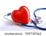 red heart and a stethoscope on... | Shutterstock . vector #709739362