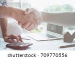 architect and customer shaking... | Shutterstock . vector #709770556