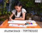 a little girl is learning to... | Shutterstock . vector #709783102