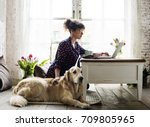 Stock photo woman petting golden retriever dog 709805965