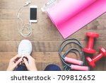 woman tying up sport shoes ... | Shutterstock . vector #709812652