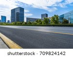 empty urban road with modern... | Shutterstock . vector #709824142
