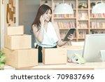 young entrepreneur checking... | Shutterstock . vector #709837696