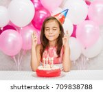 girl in the birthday hat with a ... | Shutterstock . vector #709838788