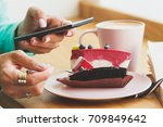 woman takes a picture of cup... | Shutterstock . vector #709849642